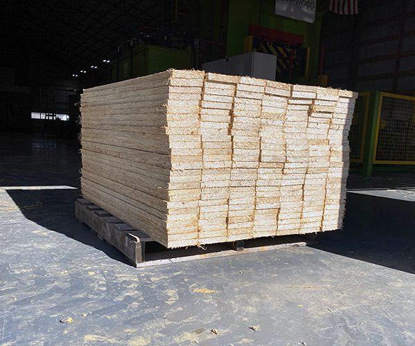 pallet of hemp boards staked outside
