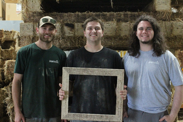 three guys holding picture frame